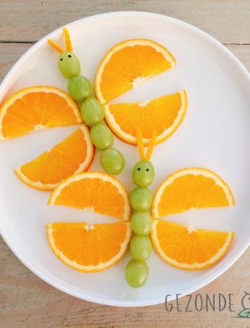 Appelsienvlinder met druiven